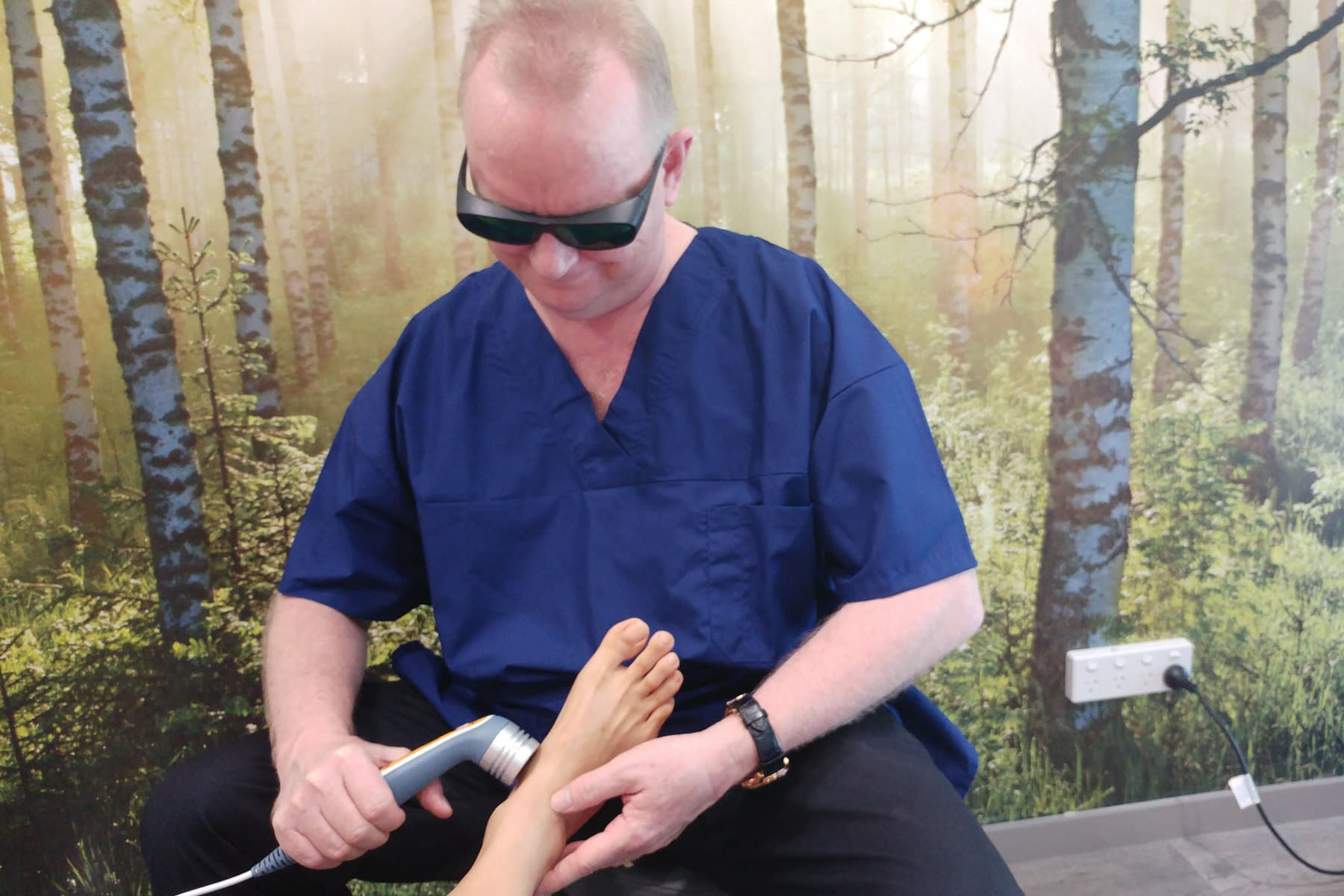 Low level laser therapy for foot pain