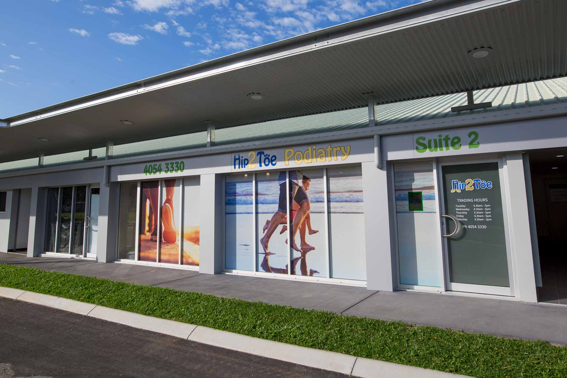 outside signs and practice of hip2toe podiatry cairns